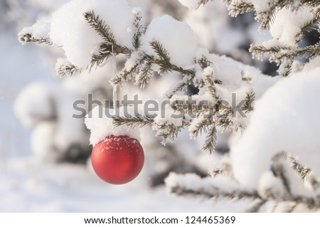 Christmas tree with decoration under snow - stock photo