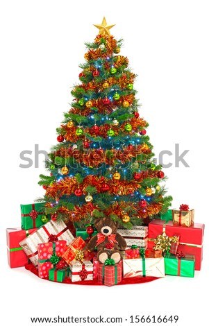 Christmas tree with decorations, baubles, tinsel and fairy lights surounded by gift wrapped presents, isolated on a white background.