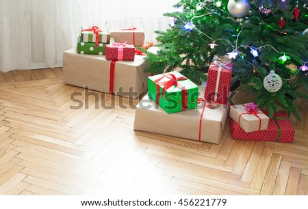 Christmas tree with festive gifts at home