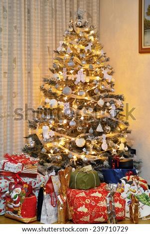 christmas tree with gifts around - stock photo