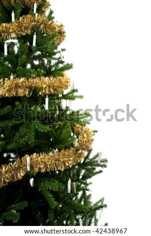 Christmas tree with golden streamers and lights in closeup over white background - stock photo