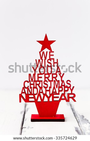 christmas tree with greeting for a merry christmas - stock photo