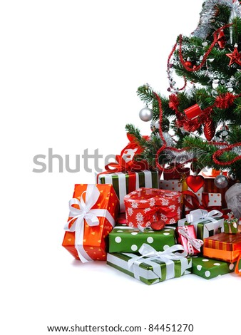 Christmas tree with heap of festive gift boxes decorated with satin ribbon isolated on white background - stock photo
