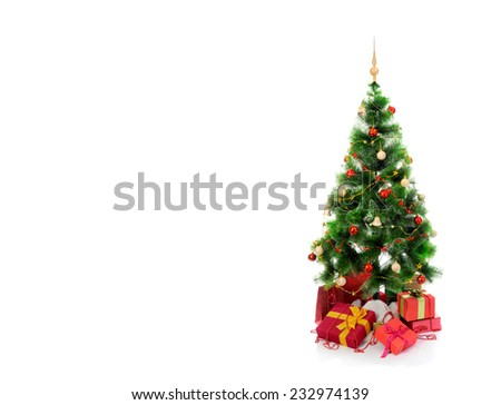 Christmas tree with heap of red gift boxes decorated. isolated on white background