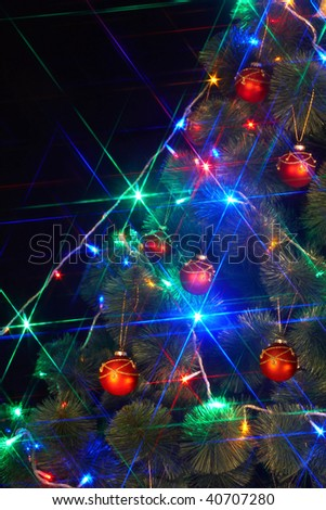 Christmas  tree with light and flash. Black background. - stock photo