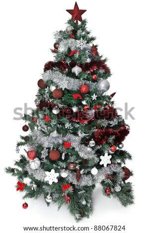 Christmas tree with lot of silver and red decoration - stock photo
