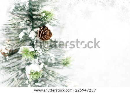 Christmas tree with pine cones, snow and Christmas lights in background. Subtle snowflake  and frosty border. Room for copy space.  - stock photo