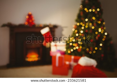Christmas tree with presents near the fireplace at home in the living room - stock photo