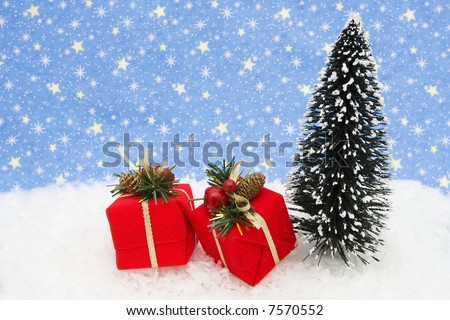 Christmas tree with presents on snow with star background - stock photo