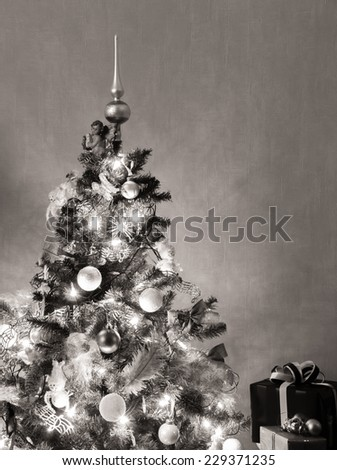 Christmas tree with presents, vintage toned - stock photo