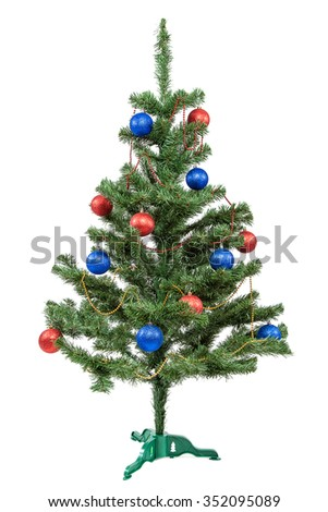Christmas tree with red and blue baubles isolated on white background. - stock photo