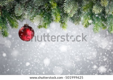 Christmas tree with red ball in snow
