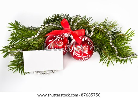 Christmas tree with red balls and blank greeting card - stock photo