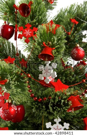 Christmas tree with red Christmas balls and decoration isolated on white background.