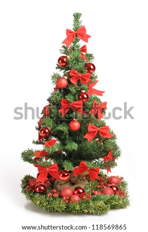 Christmas tree with red ornaments isolated on white - stock photo