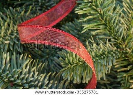 Christmas tree with red ribbon background - stock photo