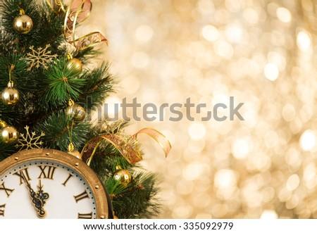 Christmas tree with retro clock face  - stock photo