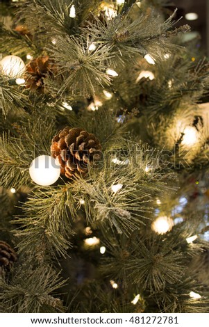 Christmas tree with white lights and pine cones