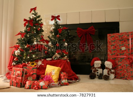 Christmas trees by a fireplace - stock photo