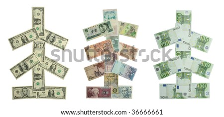 Christmas trees from different banknotes isolated on white - stock photo