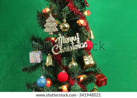 Christmas trees on a green background. - stock photo