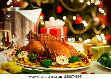 Christmas Turkey dinner served in front of a Christmas tree - stock photo