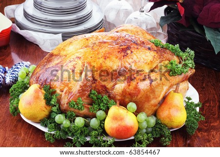 Christmas turkey dinner with fresh pears, grapes and parsley.