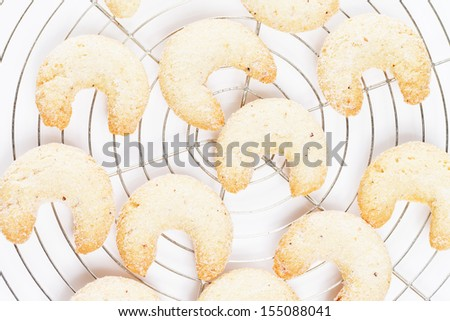 christmas vanilla crescents from top on a cooling grid - stock photo