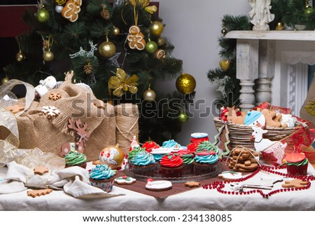 Christmas various gingerbread Christmas decoration with food, cakes, cupcakes, confection. Christmas tree with ornaments. Gingerbread man - stock photo