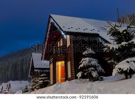 Christmas village in Carpathian Mountains. Ukraine. Night landscape - stock photo