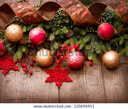 Christmas Vintage Background.Old Styled Border design.Evergreen tree,baubles and ribbon over Wooden Background.Wood - stock photo