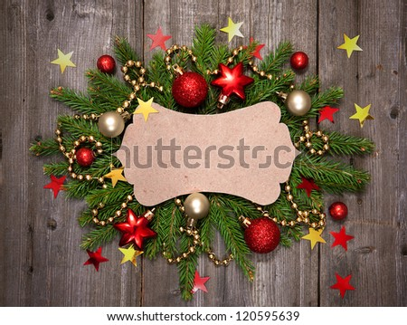 Christmas vintage card with baubles on wood texture. - stock photo