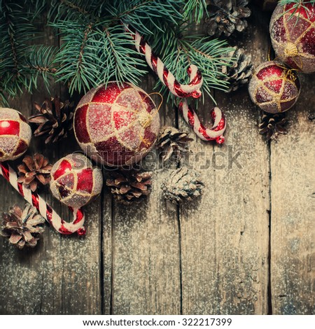 Christmas Vintage Fir Tree Toys, Red Balls, Coniferous, Candy Cane, Pine Cones as Decor on Wooden Background. Toned - stock photo