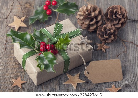 Christmas vintage present on a wooden background - stock photo