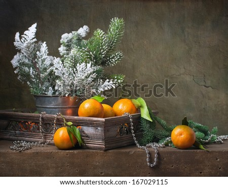 Christmas vintage still life with tangerines and  christmas decorations - stock photo