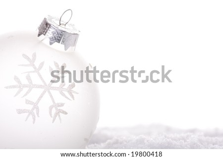 christmas white background, with a christmas ball (selective focus) - stock photo