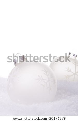 christmas white background, with snow and christmas balls (selective focus)