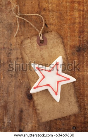 christmas white star candy on retro paper tag, wooden background