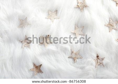 christmas white stars on fur snow background