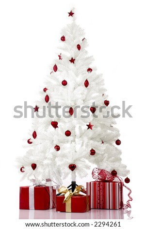 Christmas white tree and gifts over a white background - stock photo
