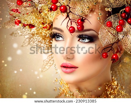 Christmas Winter Fashion Model Girl with golden hairstyle and make up. Beauty Woman. Beautiful New Year Holiday Creative Hair style decorated with holly berries. Beauty Lady face  - stock photo
