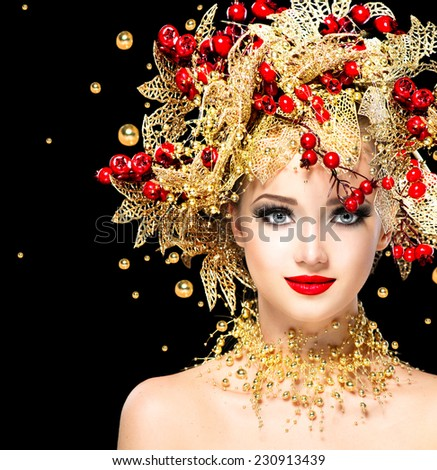 Christmas Winter Fashion Model Girl with golden hairstyle and make up. Beauty Woman. Beautiful New Year Holiday Creative Hair style decorated with Baubles. Lady face isolated on black Background - stock photo