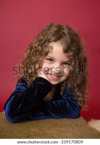 Christmas, Winter Holiday themed setup: beautiful girl laughing and smiling  - stock photo