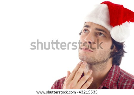 Christmas Wish: Thoughtful Young man with Christmas hat looking at copyspace, isolated over white background