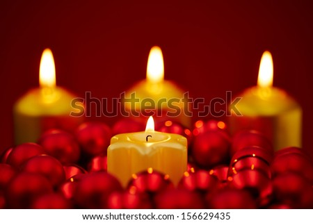 Christmas with four burning candles on a red background - stock photo