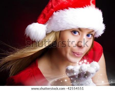 christmas woman blowing starlight dust