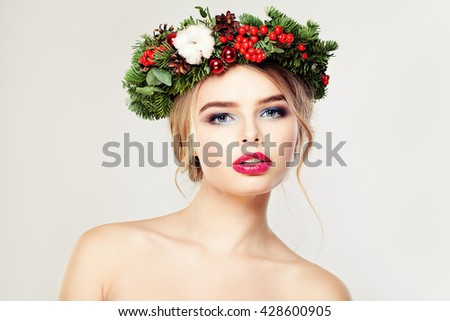 Christmas Woman. Cute Face. Healthy Skin. Makeup and Xmas Tree Wreath - stock photo