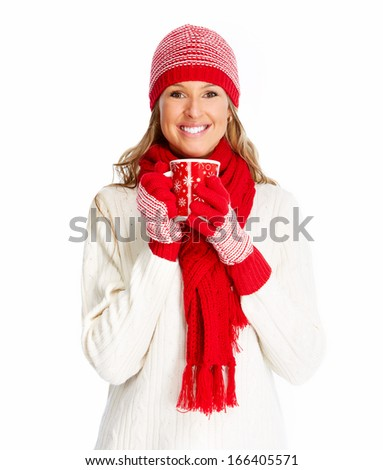 Christmas woman drinking hot tea isolated over white background. - stock photo
