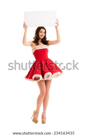 Christmas woman hold big white card. Santa dress. Isolated smiling girl. - stock photo