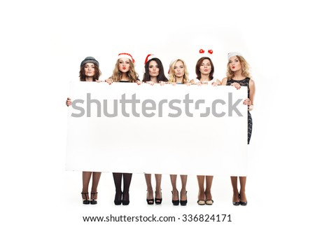 Christmas woman hold big white card. Santa hat. Isolated smiling girl. - stock photo